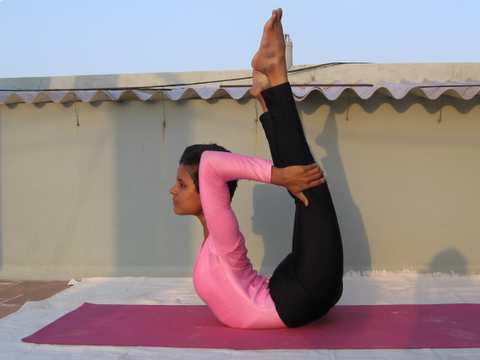 yoga a way to health dhanurasanathe bow poseurdva