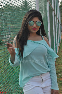 Madhulagna Das looks super cute in White Shorts and Transparent Top 11.JPG