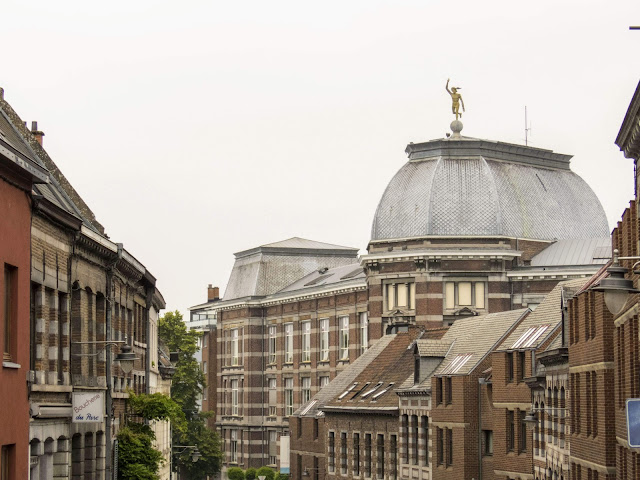 What to do in Mons Belgium: Explore architecture and the dome with statue on top