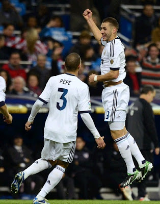 Benzema with Pepe celebrate a goal