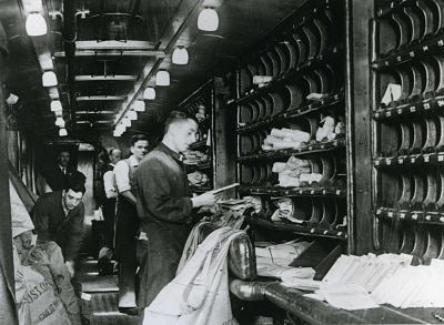 postal sorters on the mail train