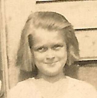 Girl cropped from photo of other children, sitting on stoop. Possible connection with boy from Boutonierre photo.