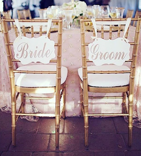 Chiavari chairs tagged with inventive place cards