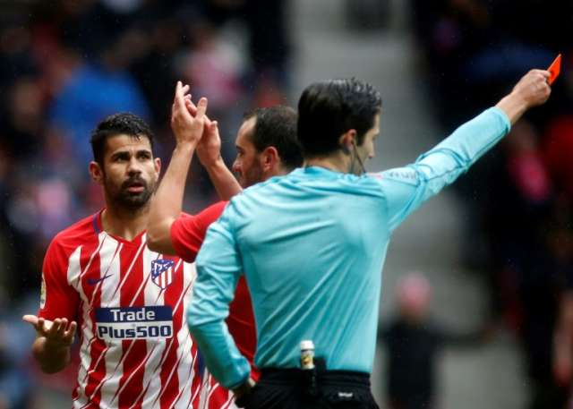 Diego Coasta kisses an exit card at Atletico after scoring the winning goal