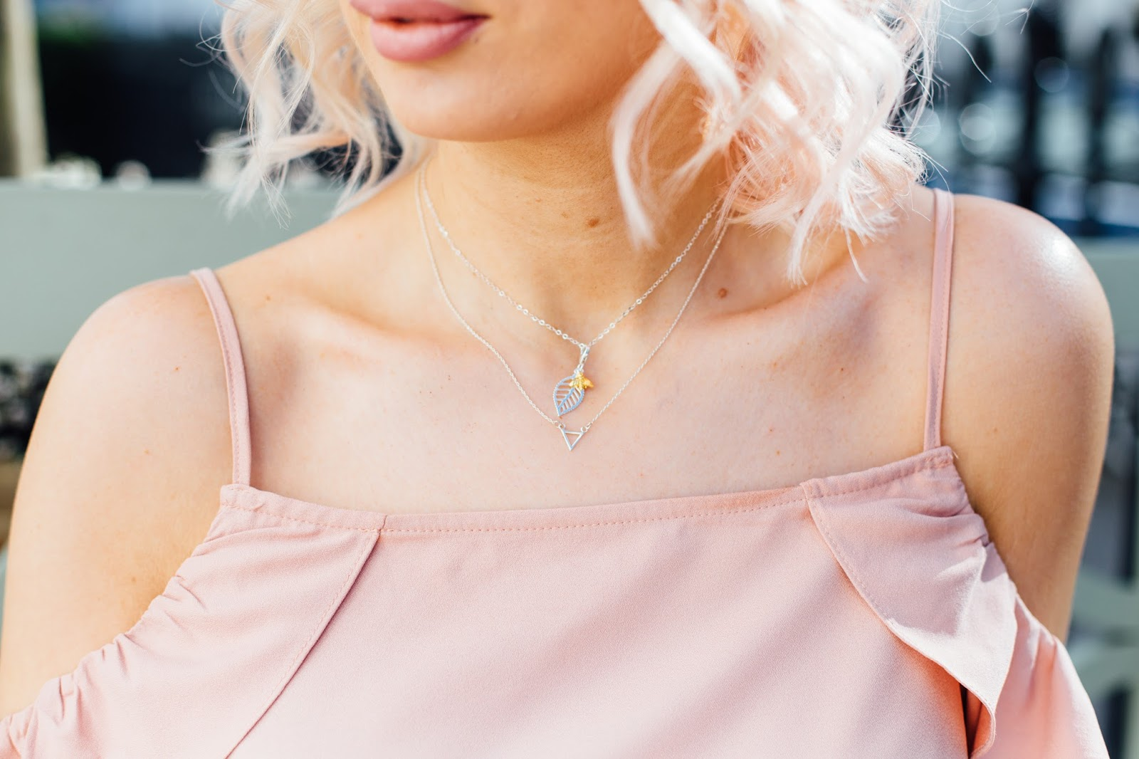 Silver necklaces from Jewellery Box styled with pink dress