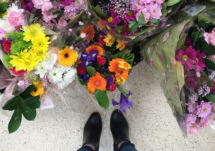 Flowers and Missguided boots.