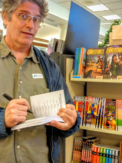 Dean A. Anderson signs Bill the Warthog books at Focus on the Family's bookstore