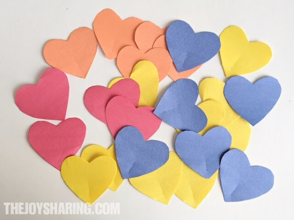 Cut out heart shapes to make paper heart flowers.