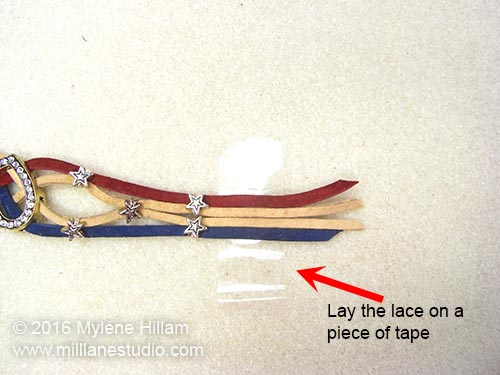 The leather lace ends have been placed on a piece of adhesive tape to keep them aligned.
