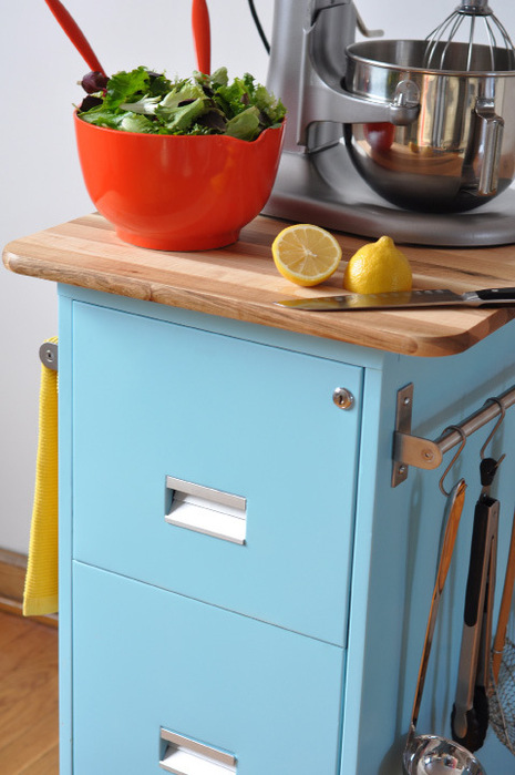 an old filing cabinet can make a great kitchen island with some paint and a new cutting board surface