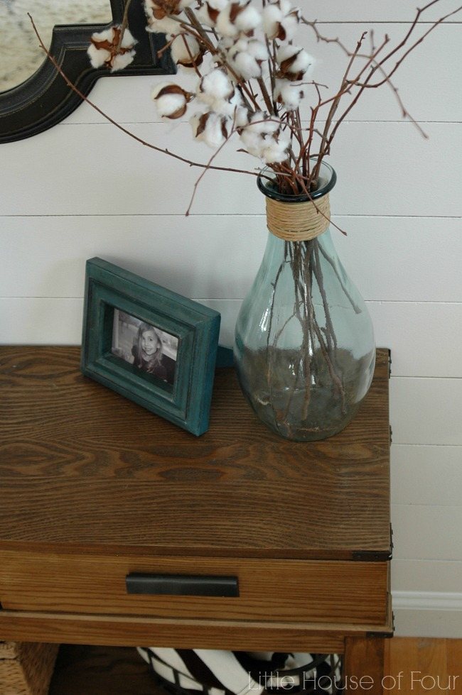 table styling in front of DIY plank wall