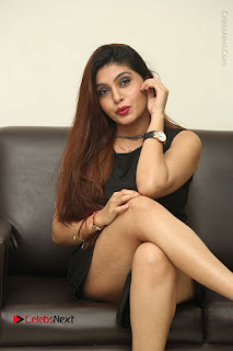 Tollywood Upcoming Actress Pooja Roshan Stills in Black Short Dress at Plus 1 Movie Trailer Launch  0268.JPG
