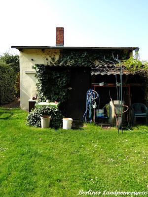 Gartenlaube und Geräteschuppen