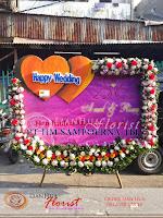 bunga papan digital printing, bunga papan pernikahan, bunga ucapan selamat, toko karangan bunga, toko bunga jakarta, toko bunga, florist jakarta, karangan bunga happy wedding, bunga papan grand opening