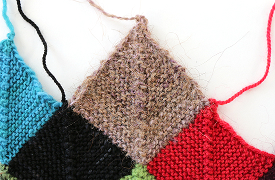 Handspun Yarn Knit into a Garter Stitch Block on a Scrap Blanket