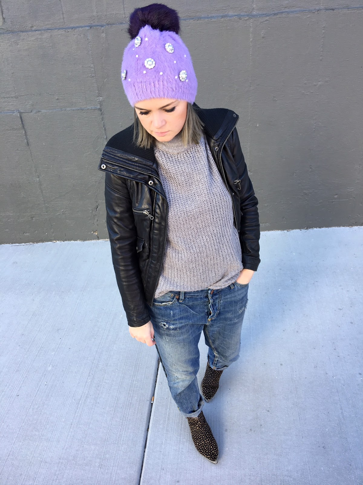 embellished purple beanie hat with a pom pom