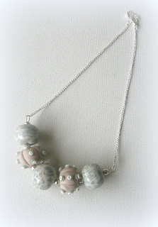 Polymer clay silver necklace with urchin tones