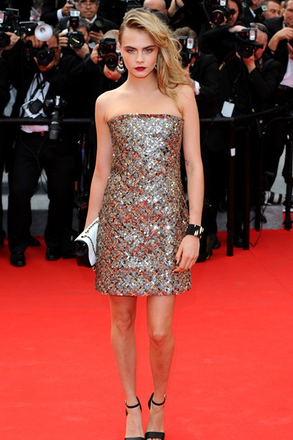 Cara Delevingne wore a gold Chanel Couture dress at Cannes 2014