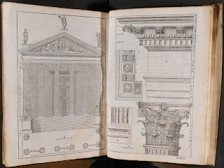 An open book of architectural drawings.