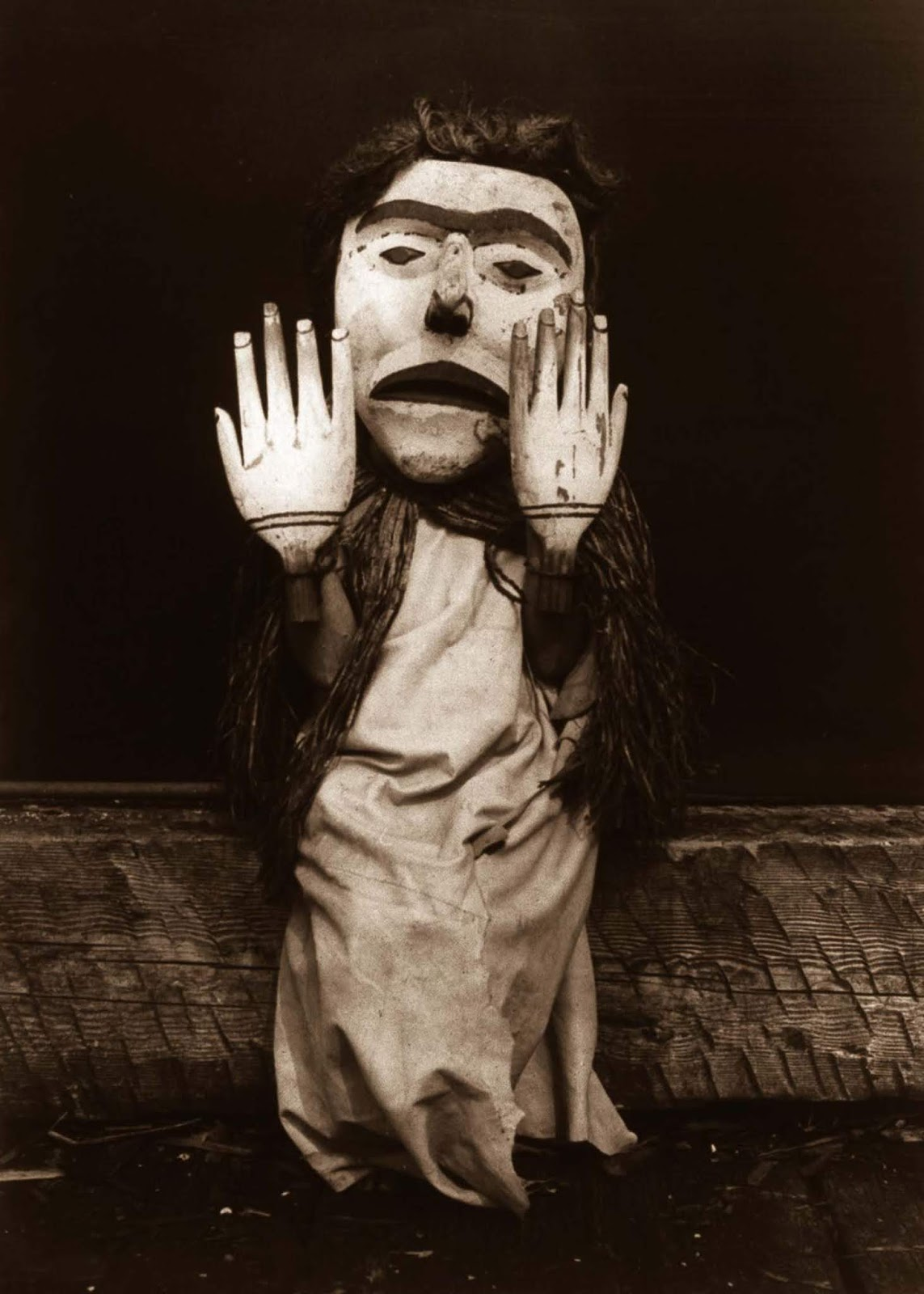 A Kwakiutl person dressed as a forest spirit, Nuhlimkilaka, (