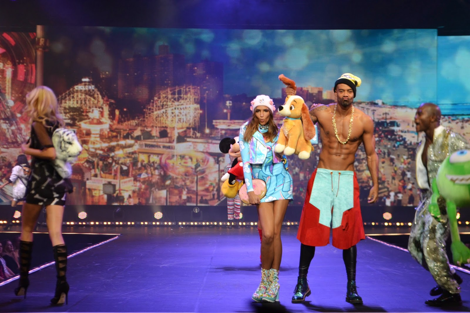 multiple models on stage wearing disney themed clothing
