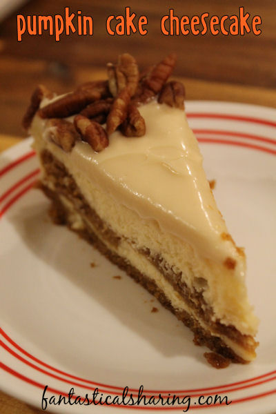 Pumpkin Cake Cheesecake // Two desserts in one topped with a luscious cream cheese frosting - pumpkin pie just can't compete! #recipe #pumpkin #cheesecake #dessert
