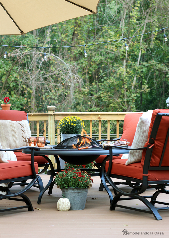 patio set in rusty red with firepit and umbrella
