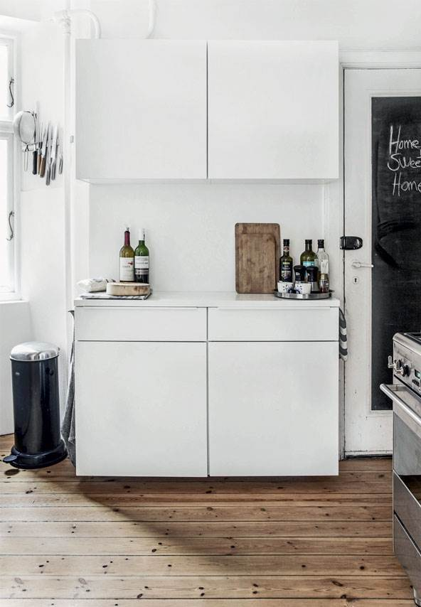 white kitchen in scandinavian apartment