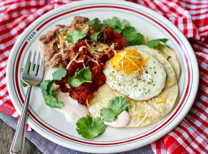 Huevos Rancheros with beans and sauce