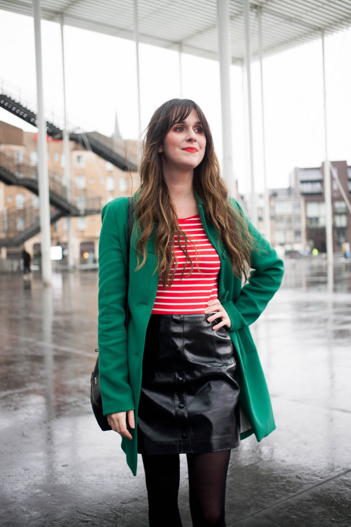 green coat, red tripes, pleather skirt