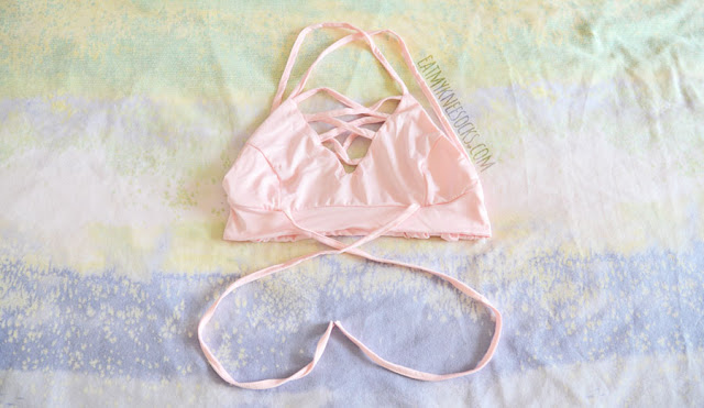 Details on the lace-up lattice front v-neckline cropped pastel pink bralette from Dresslink.