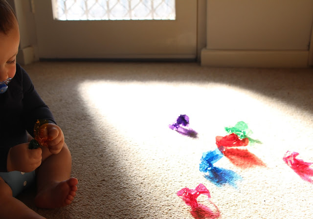 Baby exploring rainbow shadows