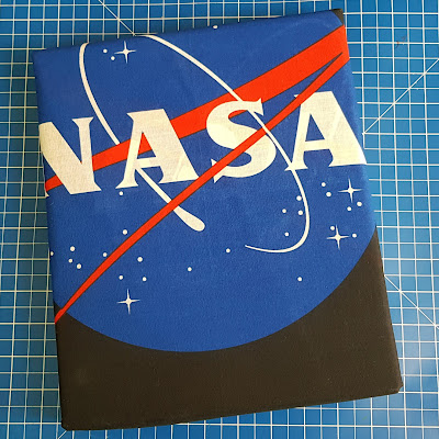 ISA NASA bedding shown folded with NASA logo
