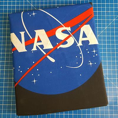 ISA NASA bedding shown folded with NASA logo
