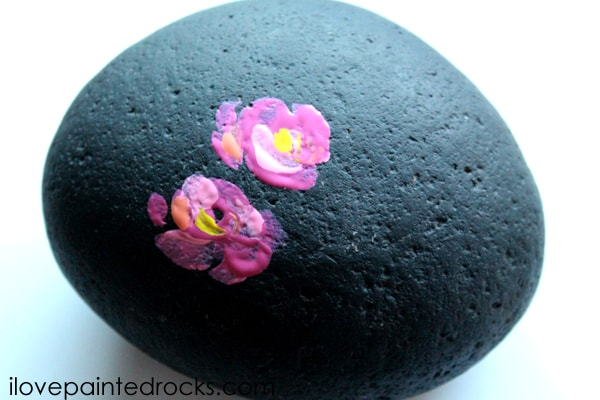 flowers on painted rock