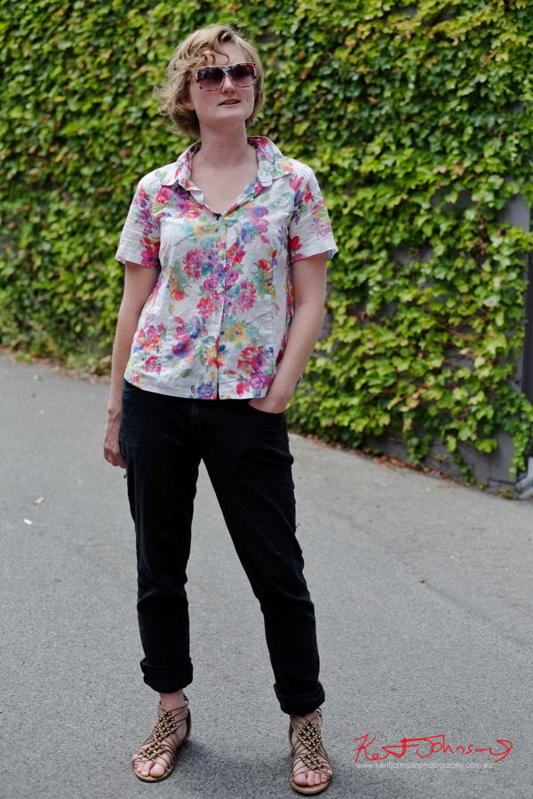 Floral pastel blouse, matching sunglasses, black jeans and beaded sandals, Balmain Sydney.