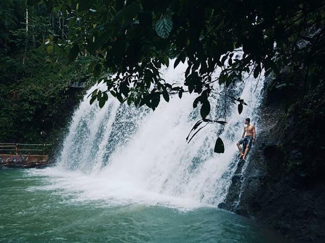 the Curug Cay Waterfall