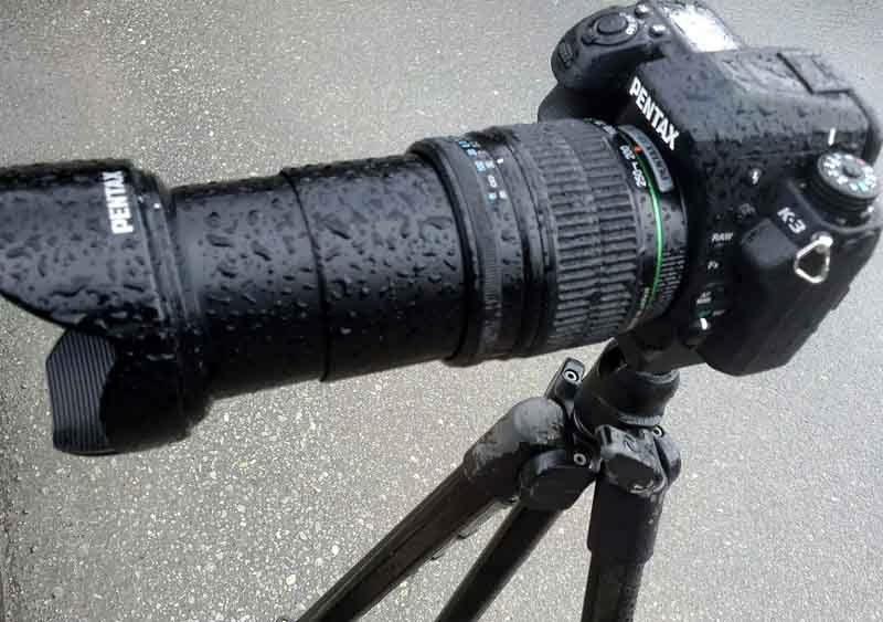 Pentax camera, tripod mounted, in rain