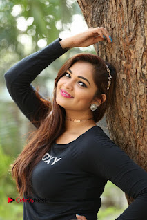 Actress Aswini Latest Stills in Black Denim Jeans  0063.JPG