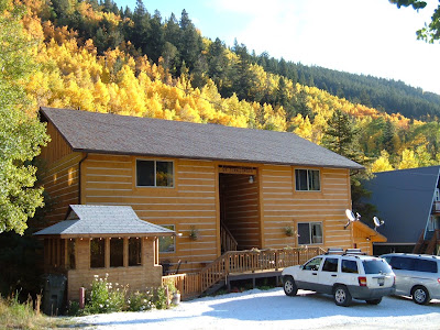 Sunny fall day, autumn gold log sided condos with mountain views all around.