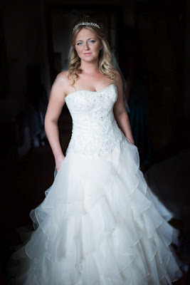 Blonde bride in Aberdeen with soft curled wedding hair