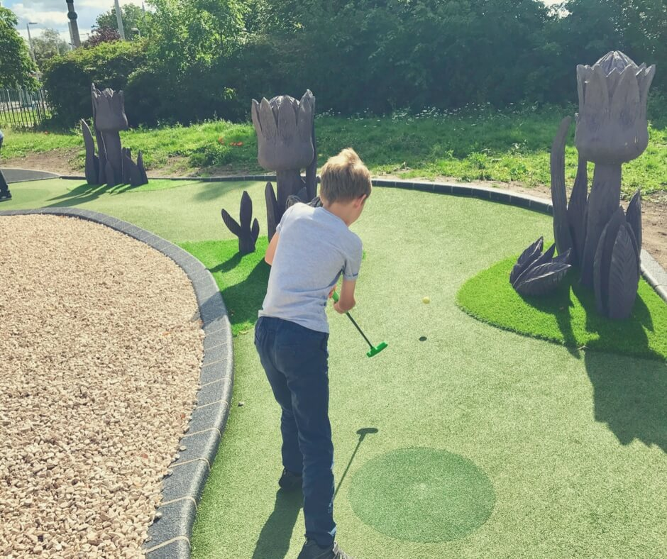 Little ball hitting golf ball into the air on Highfields Park Adventure Golf