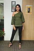Pragya Jaiswal in a single Sleeves Off Shoulder Green Top Black Leggings promoting JJN Movie at Radio City 10.08.2017 053.JPG
