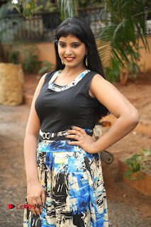Actress Model Poorni Stills in Floral Long Dress at Silk India Expo Launch  0016.JPG