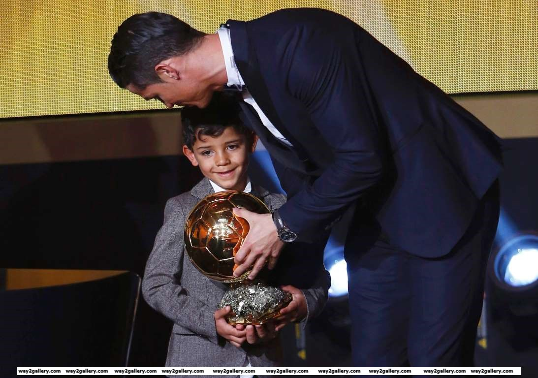 Real Madrids Cristiano Ronaldo stands with his son Cristiano Ronaldo Jr after winning the FIFA Ballon dOr  during the soccer awards ceremony at the Kongresshaus Zurich on January