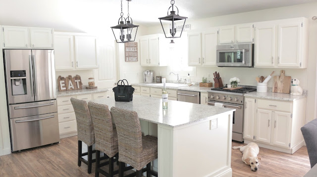 White kitchen, farmhouse kitchen, Kichler arena cove pendant. Pier one kubu