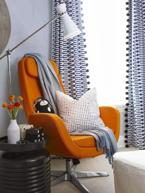 Pumpkin orange modern chair and blue curtains - Fall decor inspiration