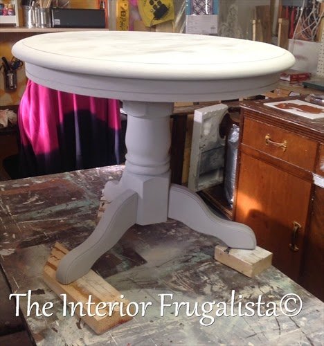 Round oak table painted with Paris Grey chalk paint