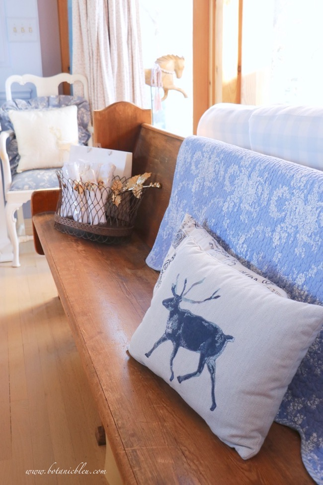 Winter blue embroidered pillow warms homes during winter