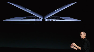 Steve Jobs giving a macbook presentation